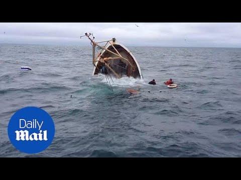 Deep sea fishermen watch on helplessly as boat rapidly sinks