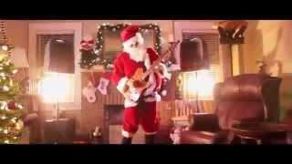 Santa Rocks Out to Feliz Navidad