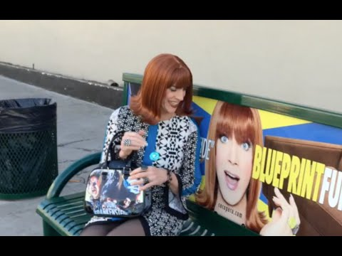 Coco Peru finds her bus stop