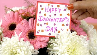 Beautiful pink and white flowers with a cute Happy Daughter's Day greeting card