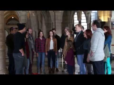 "Touring cast of ""Once"" singing ""Gold"" in Rotunda of Parliament buildings"