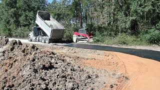 Installing The Road Culvert And Stone Spreading