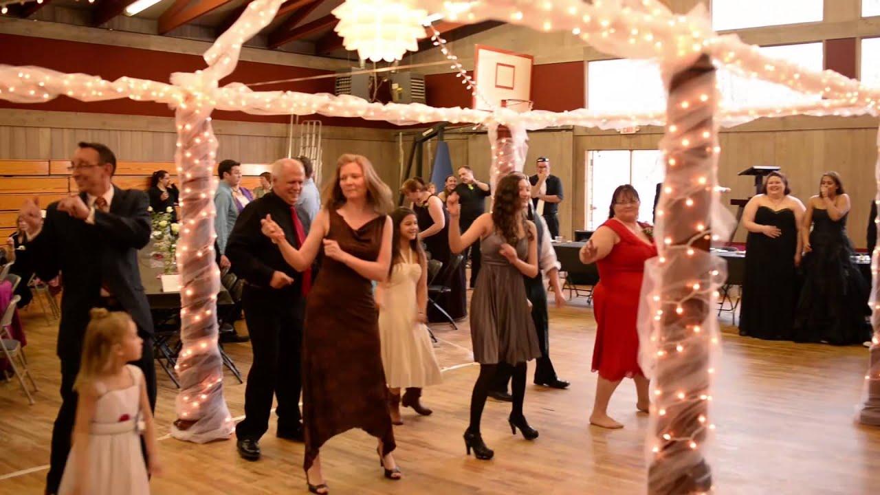 flash mob happy dance by pharrell at a wedding reception