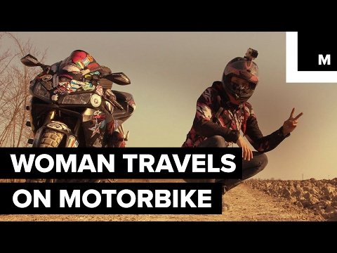Woman makes an epic solo world tour on a motorbike