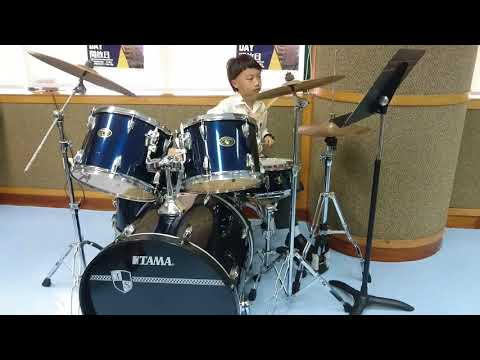 Caius' first performance on drum at Macau Anglican College
