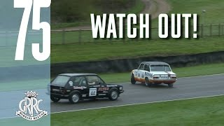 Touring cars in wild sliding action at Goodwood