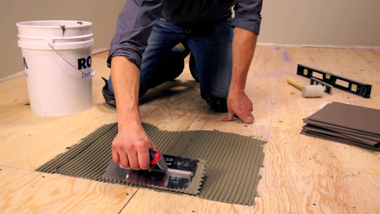 Rona how to lay floor tiles youtube for Laying flooring