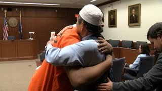 Father forgives, hugs man involved in his son's killing