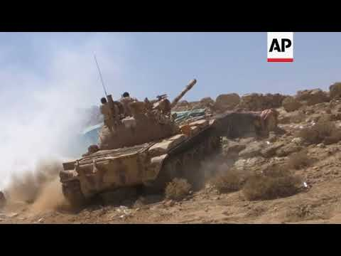 Saudi-backed troops battle