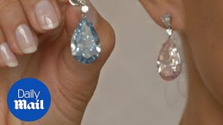 Diamond earrings sell for over $57 million at Sotheby's - Daily Mail