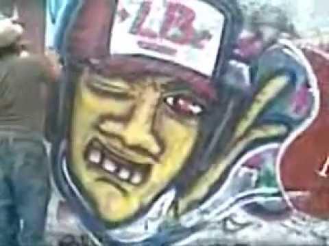 Graffiti urban art Young people painting graffiti on main avenue