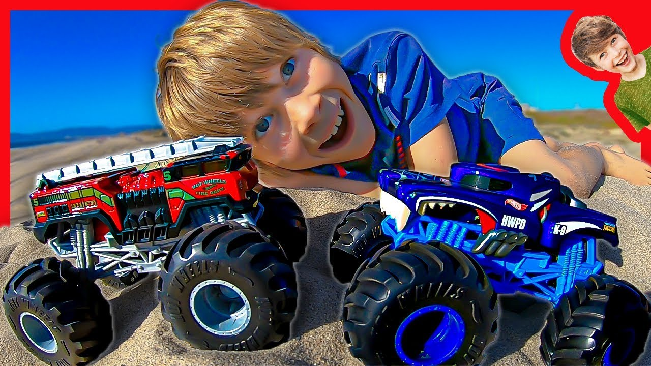 Hot Wheels Monster Trucks At The Beach With Axel And Daddy Youtube