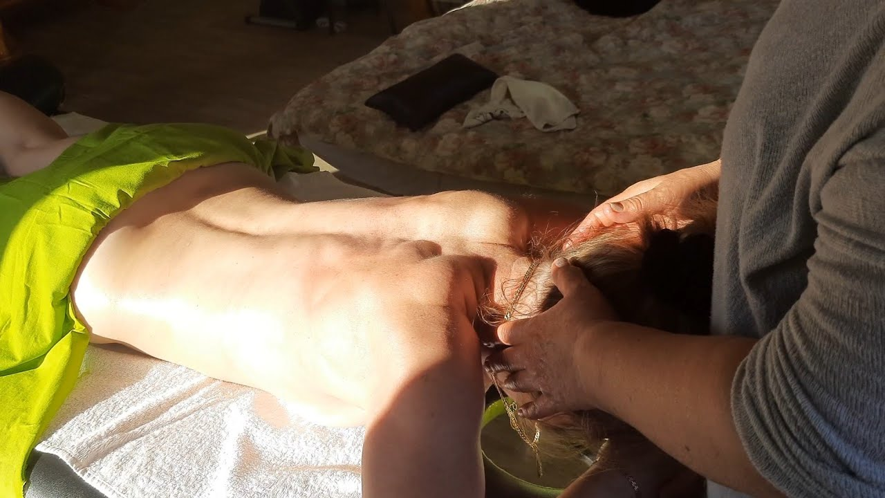 Unclench muscle clamp of ex-athlete. Full body massage