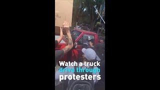 Watch as a truck drives through protesters in Tallahassee