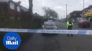 Street cordoned off in Manchester after teenage boy is shot - Daily Mail