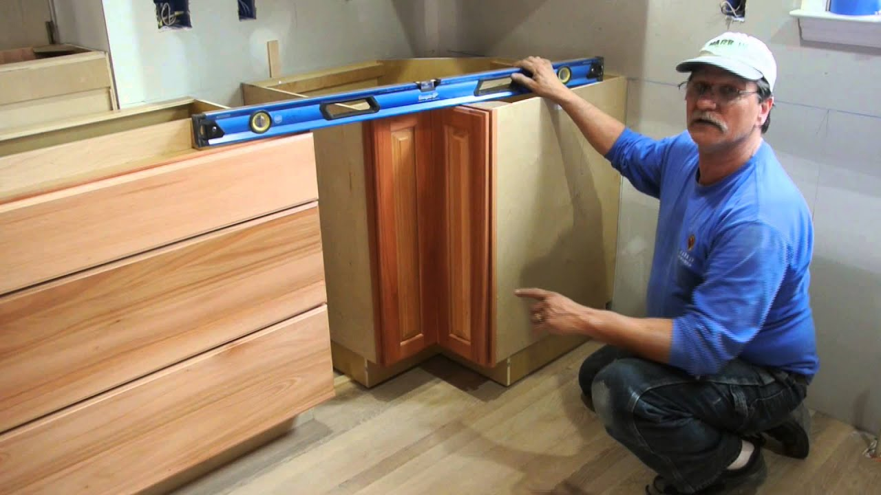 How To Set A Base Cabinet On A Hump In The Floor Youtube