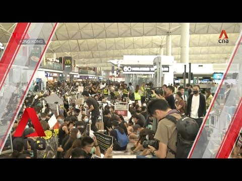 Protesters block departure hall at Hong Kong International Airport