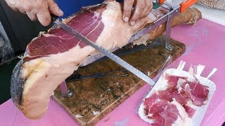 Italy Street Food. Slicing a Huge Dry-Cured Ham.