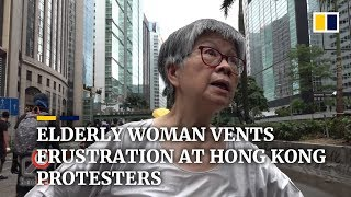 Elderly woman vents frustration at Hong Kong protesters