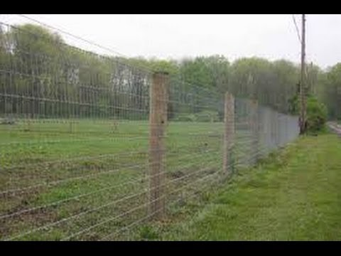 installing woven wire fence on a hill 2
