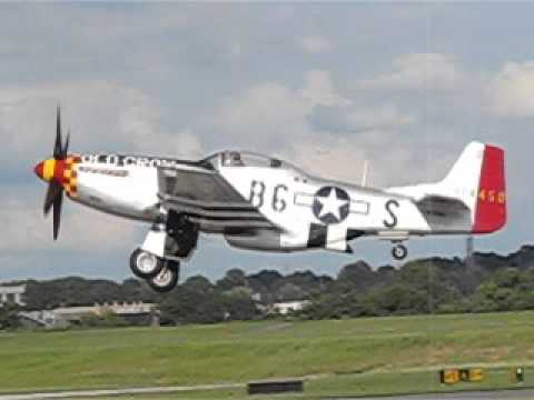 4 P-51s take off at Peachtree Dekalb 2015 warbird fly in.