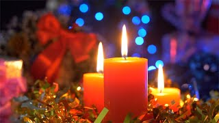 Bokeh shot of burning candles rotating on a decorated turntable against a festive background