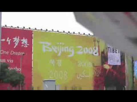 Free Tibet banner on Olympics billboard at Beijing's