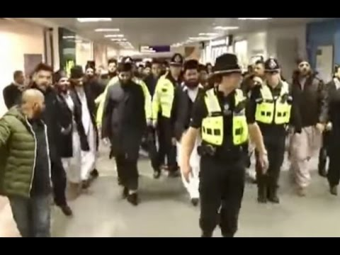 Weird Video: Islamic Preacher Arrives in UK With Police Escort