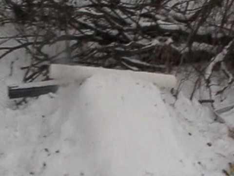 backyard snowboard terrain park - YouTube
