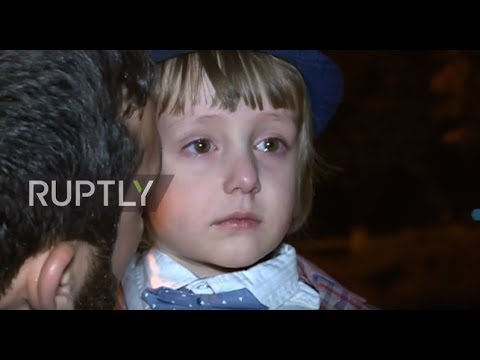 Russia: Tears pour as toddler abducted by father to IS in Iraq returns to his mother's arms