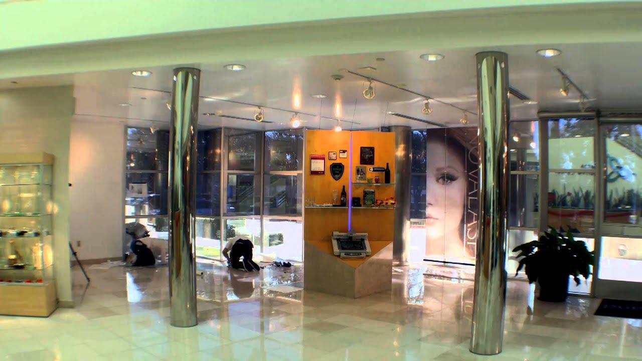 Installing custom printed vinyl floor tiles in the Roland DGA Showroom