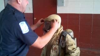 Ryan learns that fireman gear is claustrophobic.