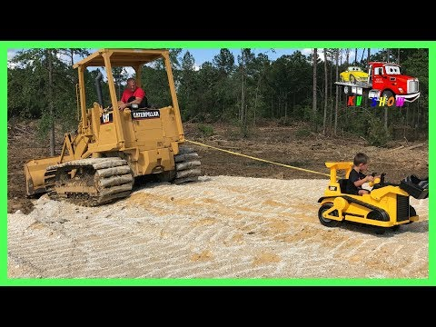 Kruz Helping Dada Powered Ride On Bulldozer Pulling Out The CAT Track Loader Playing Fidget Spinner