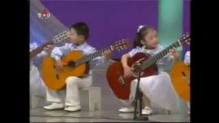 North Korea Kindergarten children Playing the Guitar of North Korean music