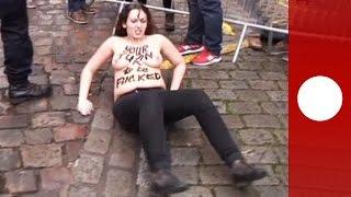 Topless Femen protesters jump on Strauss-Kahn