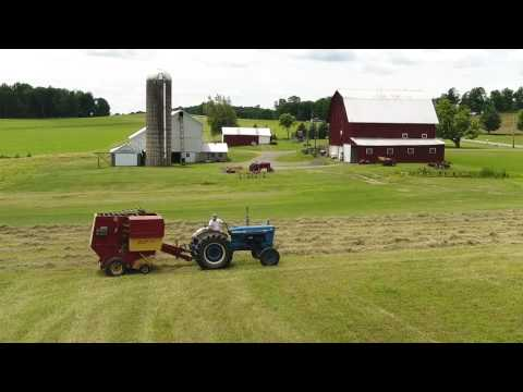 Drone Captures Tractor Baling Hay on a Beautiful Pennsylvania Farm