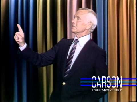 Johnny Carson tries to get through a joke with help from his staff ...