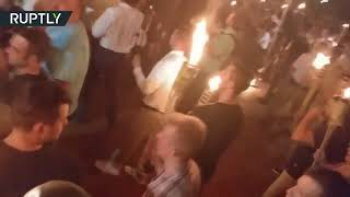 Arrests reported as Charlottesville torch-lit rally results in scuffles