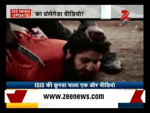 Shocking: New ISIS video shows English-speaking boy beheading man thumbnail