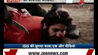 Shocking: New ISIS video shows English-speaking boy beheading man