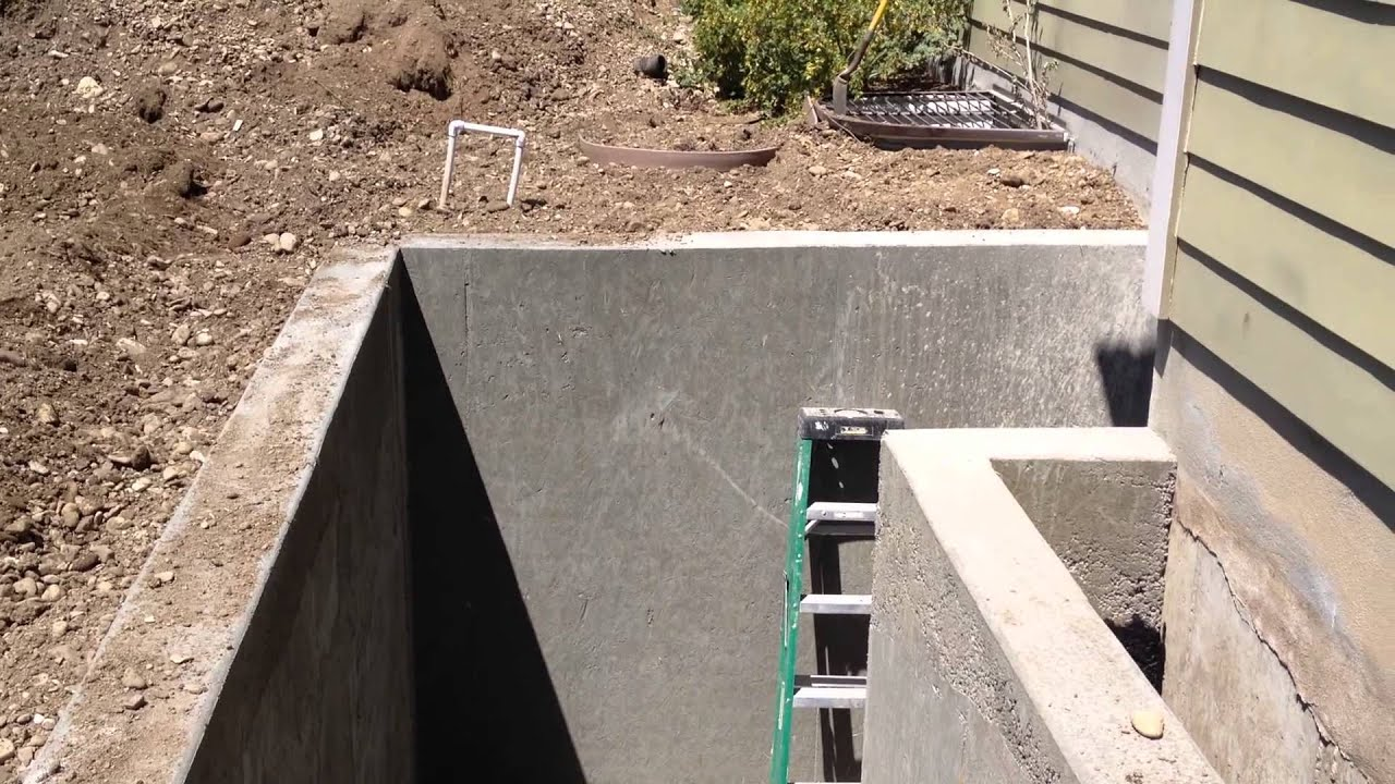 Basement entrance door construction retaining wall for Build best construction