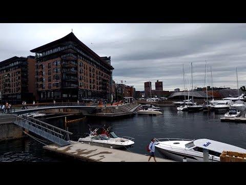 Walking through the Aker Brygge waterfront neighborhood in Oslo, Norway