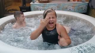 Kids chilling in inflatable hot tub 😎