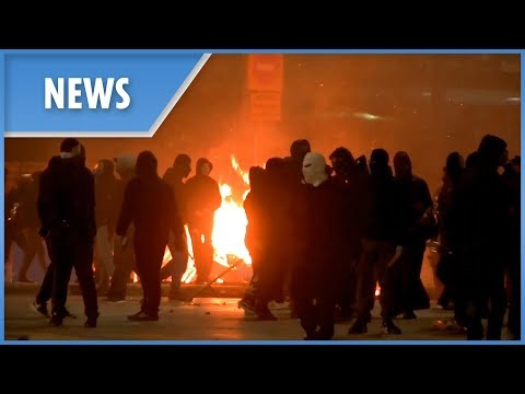 Greece: petrol bombs, fireworks and explosions as Athens becomes a war zone