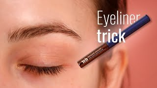 Lifting downturned eyes wİth an eyeliner