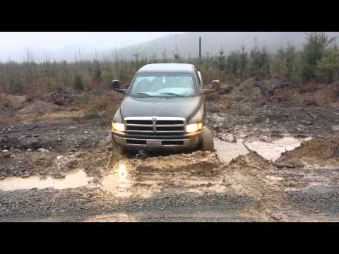 lifted dodge 1500 in a mud hole - Dodge Ram 1500 Lifted Mudding