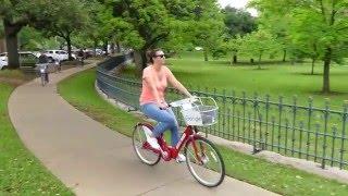 4K . Lumix FZ300 . Tourists Enjoying Rental Bikes in Downtown Austin Texas
