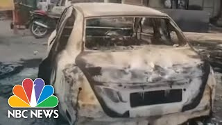 Muslim Shrine Burned As Deadly Clashes Mar Trump's Visit To India | NBC News