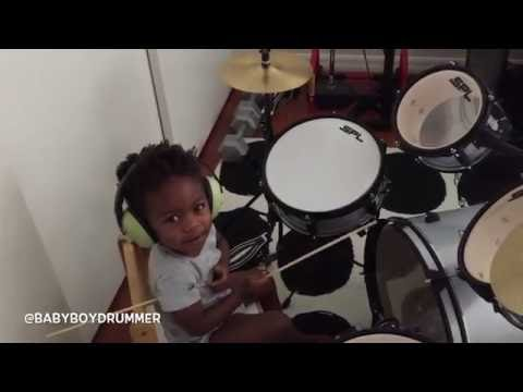 2 yr old LJ warming up on the drums.