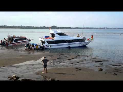 Passenger boats stuck at low tide. Sanur Beach, Bali, Indonesia